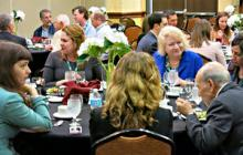 Conference attendees enjoy conversation as they await lunch preceding the awards ceremony.